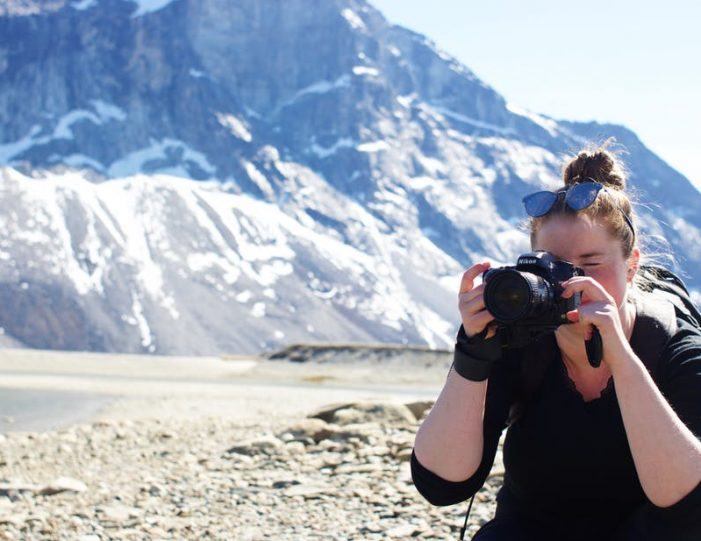 woman-taking-picture-in-nuuk-fjord-guide-to-greenland-13